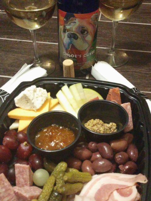 Meat and cheese tray from AVI Sea Bar and Chophouse with Chloe's Cuvee from Grace Hill Winery